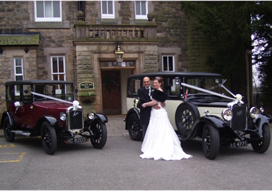 Vintage wedding cars at a recent wedding reception with Bride & Groom